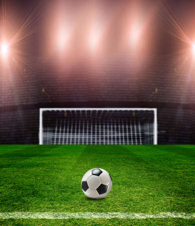 soccer ball on grass: soccer field with a ball Stock Photo