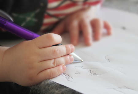 splayed:  small child s hand writing in notebook Stock Photo