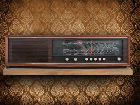 Antique radio on retro background photo