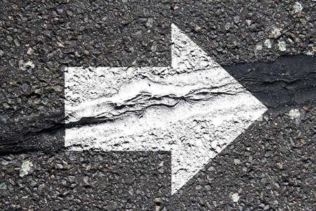 asphalt texture: Asphalt texture with white arrow
