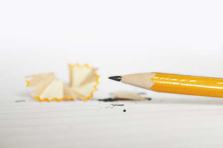 sharp yellow pencil on white