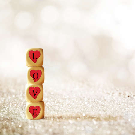desire: Wooden dice with the word love