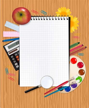 Retour à l'école. Cahier d'écolier avec les fournitures.