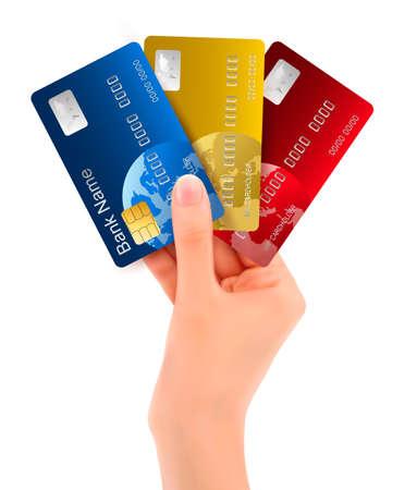 tarjeta visa: Mano masculina que muestra las tarjetas de crédito de la ilustración