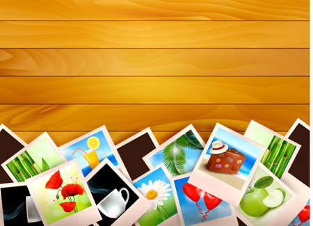 album photo: Colorful photos on wooden background