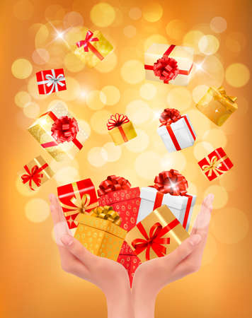 gift giving: Holiday background with hands holding gift boxes. Concept of giving presents