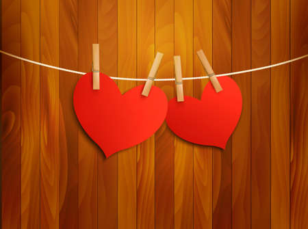 rope vector: Two red loving hearts hanging on a rope. Vector illustration