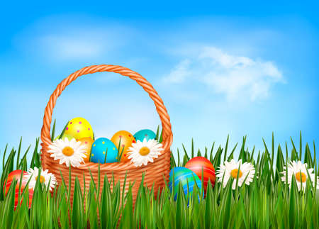 easter basket: Easter background  Easter eggs and flower with basket in the grass