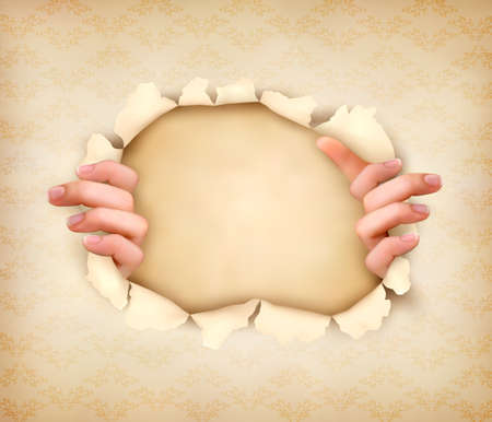 penetracion: Fondo de la vendimia con las manos que muestran a través de un agujero en el papel viejo