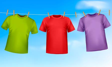 photorealistic: Set of colored t-shirts hanging on a clothesline.