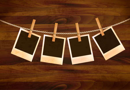 Retro photos hanging on a rope on dark wooden background. Vector. Stock Vector - 19240175