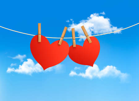 Two hearts hanging on a rope in front of a sky. Valentines day vector.  Vector