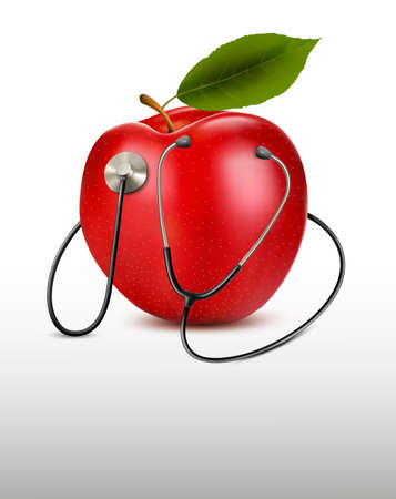 stethoscope heart: Stethoscope and red apple  Medical background