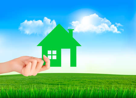 The house in hand on green natural background. Vector. Vector