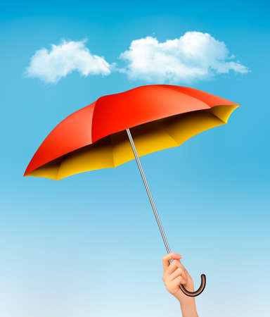 umbrela: Hand holding a red and yellow umbrella against a blue sky with clouds. Vector.