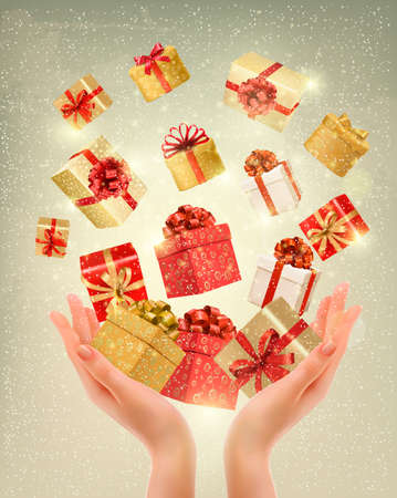 Christmas gold background with gift boxes and hands. Vector illustration.