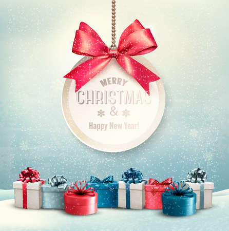 christmas gifts: Merry Christmas card with a ribbon and gift boxes.