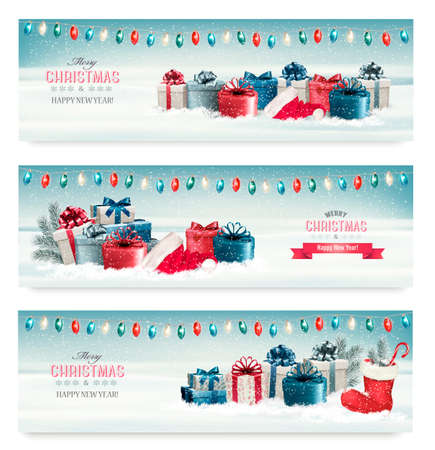 Three Christmas banners with presents. Vector. Vettoriali