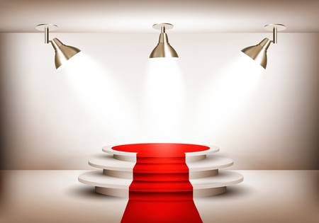 Showroom with red carpet leading to a podium and three lights.