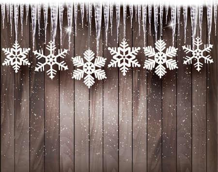 Kerst achtergrond met sneeuwvlokken en ijspegels in de voorkant van een houten wand.