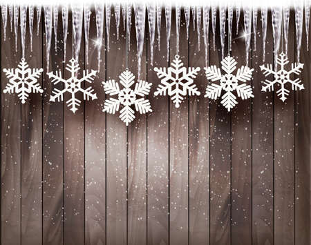 Christmas background with snowflakes and icicles in front of a wooden wall.