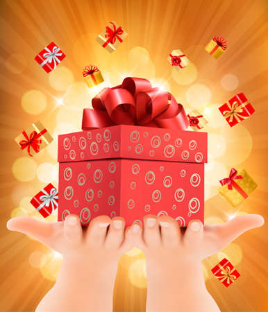desember: Holiday background with hands holding gift boxes. Concept of giving presents.