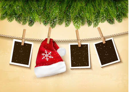photo: Christmas tree branches with photos and a Santa hat. Vector.