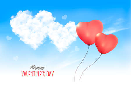 Two valentine heart-shaped balloons in a blue sky with clouds.
