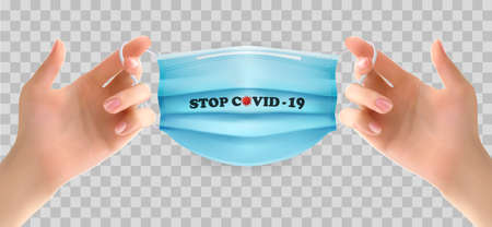 Two hands holding a blue medical mask. Stop Coranavirus concept background.