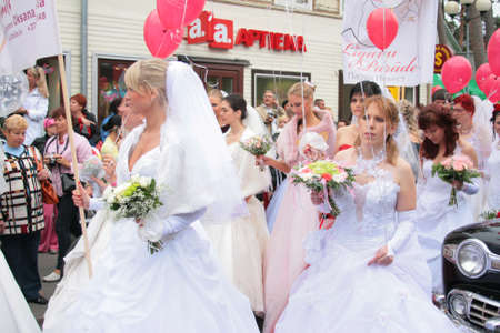 jurmala: JURMALA - JUNE 13: 2nd annual wedding parade in resort city. Each year many brides from all country are participating in Bride parade - June 13, 2010 in Jurmala, Latvia. Editorial