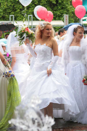latvia girls: JURMALA - JUNE 13: 2nd annual wedding parade in resort city. Each year many brides from all country are participating in Bride parade - June 13, 2010 in Jurmala, Latvia. Editorial