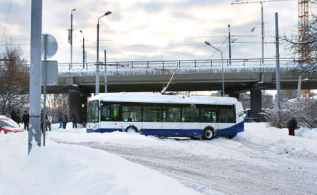 Dangerous traffic accident with public transport in Riga, Latvia on February 2, 2010. Trolleybus stuck in snow and blocked driving on slippery road. Massive snow in everywhere due to unbelievable winter storm in Europe. Luckly nobody is hurt. Stock Photo - 9386873