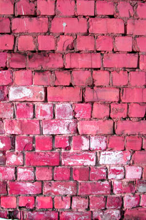 pink and brown: Brick wall background. Could be used as a texture or a background for design. Stock Photo