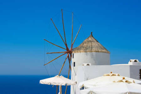 Windmill in Oia village on island of Santorini, Greece  photo