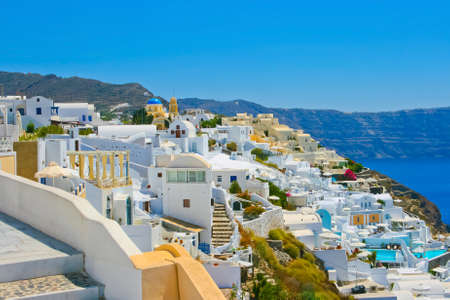 Magic view of Oia on island of Santorini in Greece. Amazing architecture with famous churches.