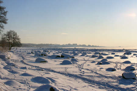 Beautiful winter landscape in a cold sunny day, near city of Tallinn in Estonia. Part of Baltic Sea is frozen. photo