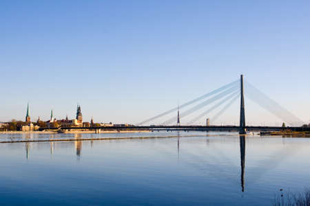 Classic view of Old Riga in Latvia. Cable-stayed bridge over the river of Daugava and Riga castle with Riga Cathedral in a front. TV tower, railway bridge and Saint Peter's church in a background. Stock Photo - 9828484