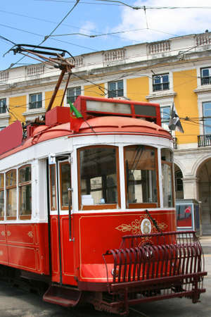 Beautiful touristic old red tram on a street in Lisbon, Portugal. This is classic artwork and also transportation for this city.