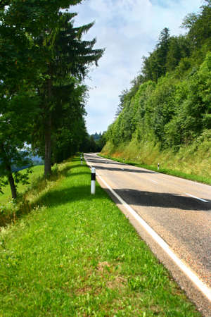 kilometre: Higher mountain road on Switzerland Stock Photo