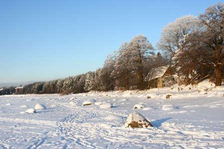 Beautiful winter landscape in a cold sunny day, near city of Tallinn in Estonia. Part of Baltic Sea is frozen. Stock Photo - 10046004