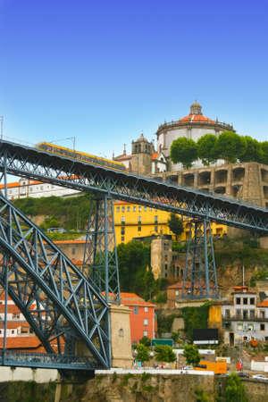 Fantastic panorama of Dom Luis Bridge with tram in center of Porto in Portugal