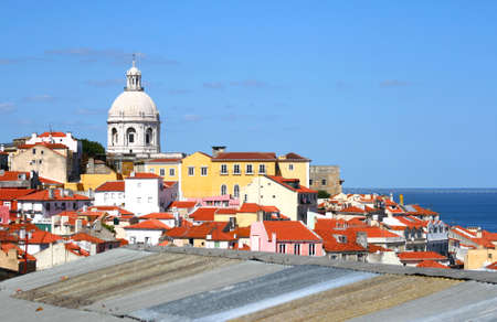 roof light: Sunset over the red roofs in Lisbon, Portugal Stock Photo