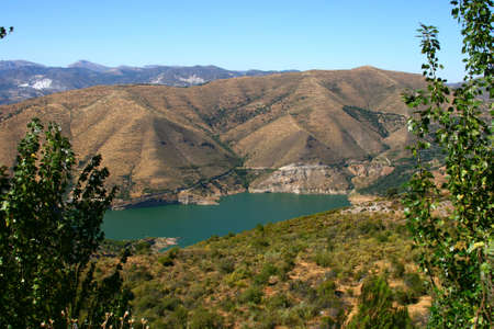 high sierra: Blue lake Sierra Nevada Mountains, near Granada Stock Photo