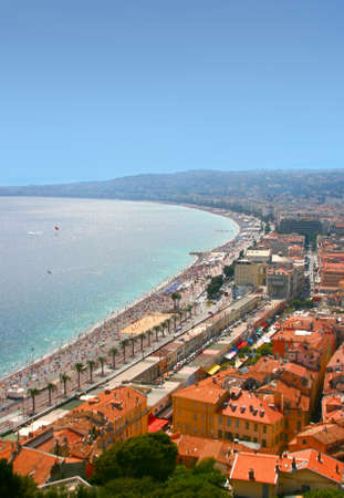 Luxury resort of French riviera. Beautiful panorama city of Nice in France. Sunny, summer day on Cote dAzur in Mediterranean sea, public beach, famous quay, palms and houses of Nice.