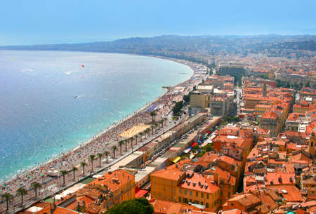 Aerial view of Luxury resort of French riviera. Beautiful panorama city of Nice in France. Sunny, summer day. Mediterranean sea, public beach, famous quay, palms and red tile roofs of Nice. Standard-Bild