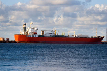 tanker ship: Empty oil tanker is loading in port of Ventspils, Latvia.  Stock Photo