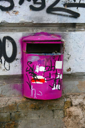 purple metal: Purple metal recycling bin with splashes of graffiti on the street in center of Riga, Latvia.
