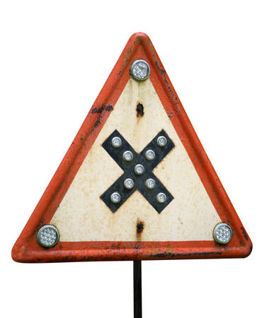 This sign warn of road crossings at even level. Crossroads with right-of-way from the right. This is rare and old sign is located in Latvia. Isolated on white close-up object. Clipping path included.
