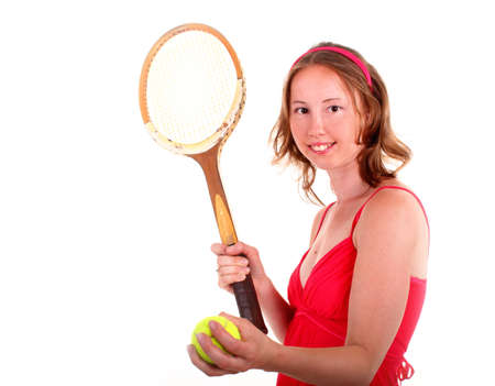 Adorable sporty woman in beautiful red dress is playing in tennis. Isolated on white background. photo