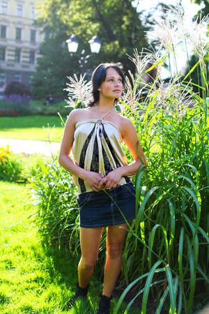 latvia girls: Young lady is standing in bush of reed in central park near to Bastion hill at summer day in Riga, Latvia